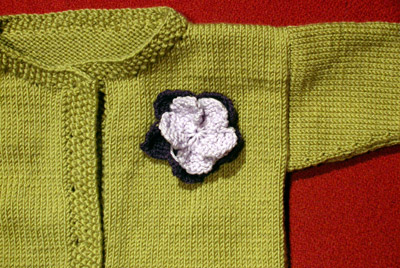 Debbie Bliss Jacket With Moss Stitch Bands - do you like the flower?