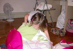 Isabelle opening her quilt