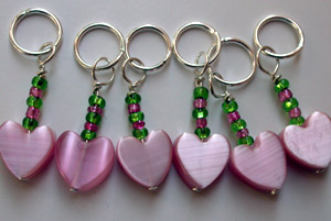 Pink and green heart stitch markers